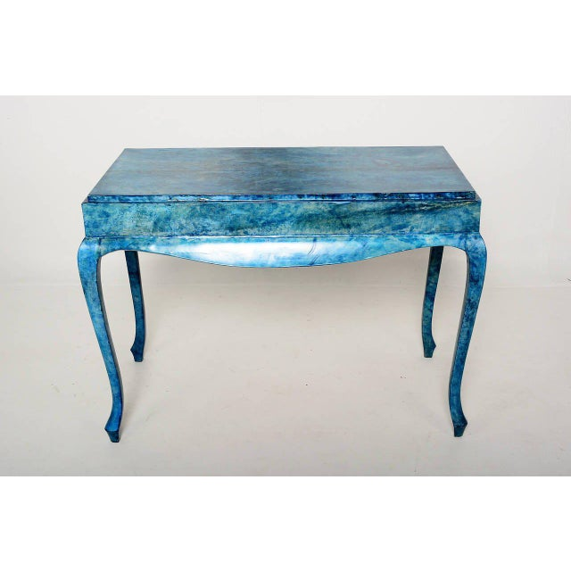 For your consideration a goatskin wrapped console table in blue color. No stamps from the maker present. Table has a...