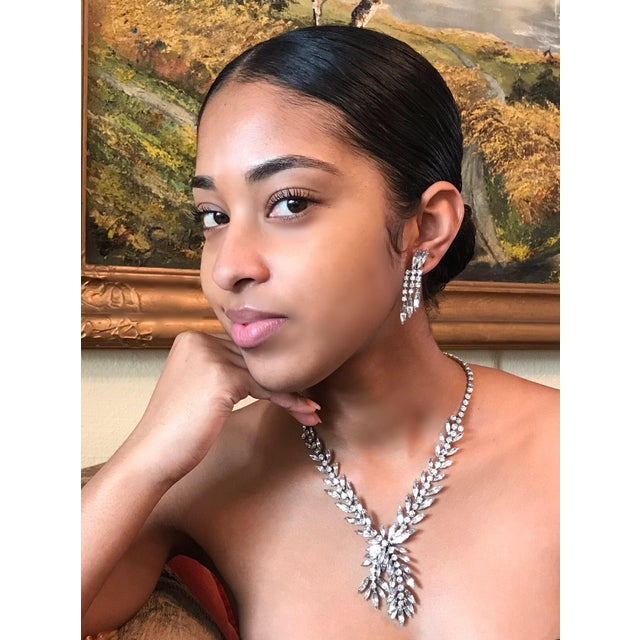 Circa 1970s stunning crystal and glass faceted marquis and round stone cocktail necklace with matching clip back earrings....