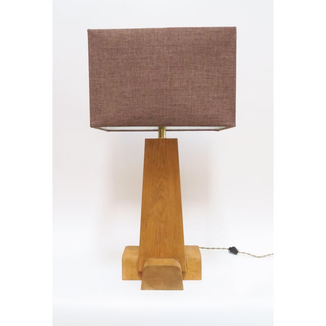 Cross Base Table Lamp made of solid pine and finished with a wax sealant. Brown linen shade.