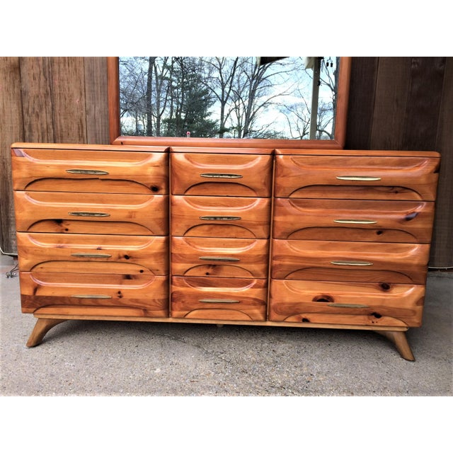 Extra wide, solid wood mid-century dresser with sculptured wood drawer fronts and original brass hardware from the famed...