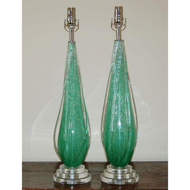Rare COKE BOTTLE GREEN Pulegoso Venetian glass table lamps with Clear applied glass wings. The Pulegoso technique creates...