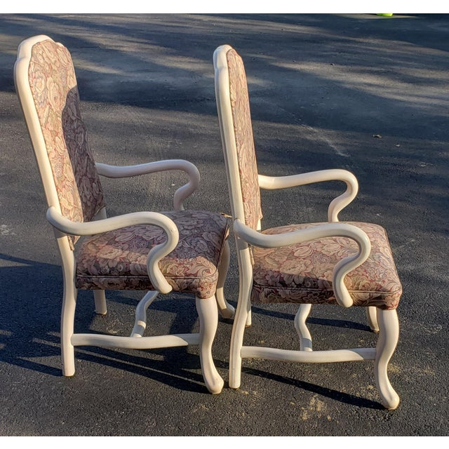 2 Vintage elegant high back arm chairs upholstered in floral vinyl that is in excellent condition. The framing is easy...