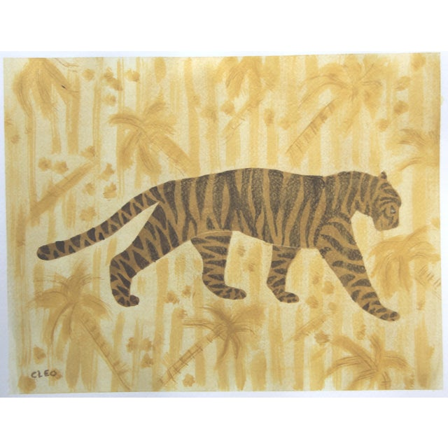 .Abstract painting of a tiger in shades of gold on a textured gold background of palm tress or tropical jungle foliage....