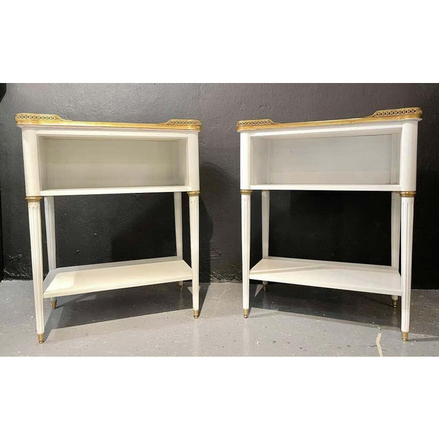 Pair of Swedish neoclassical open nightstands or end tables in the manner of Maison Jansen. These finely crafted open end...
