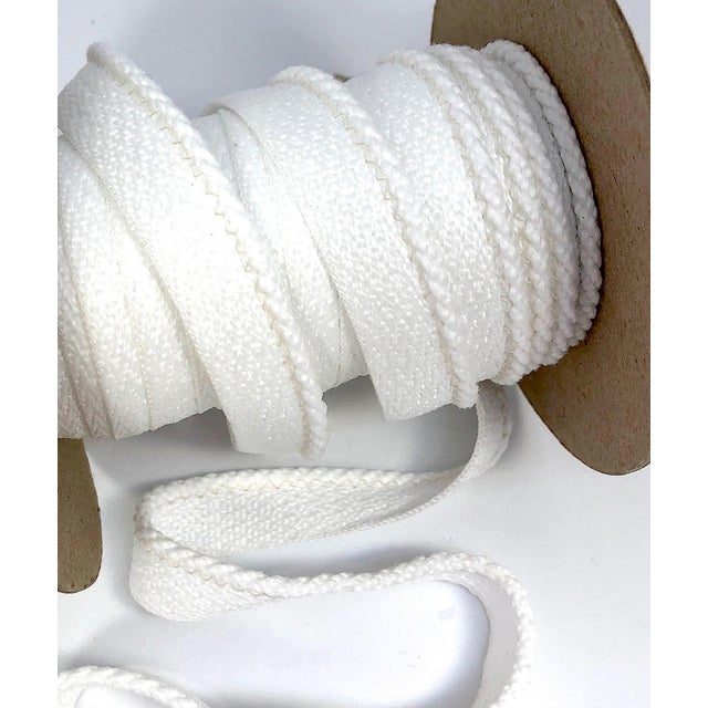 "One, 22 yard spool of 1/8"" Indoor/Outdoor cabled cord with flange. Color: White/White Flange is 1/2"" wide for sewing into..."
