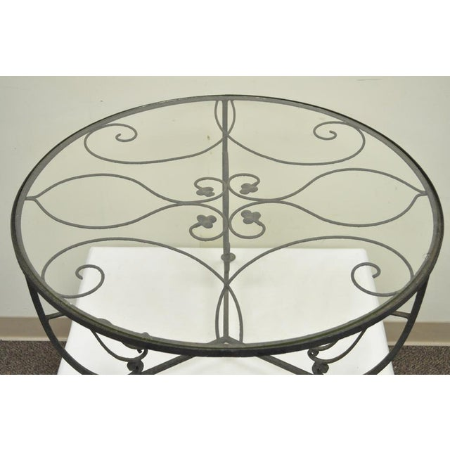 Item: Vintage Salterini Wrought Iron Art Nouveau Floral Round Glass Top Coffee Table. Details: Inset glass top, Shapely...