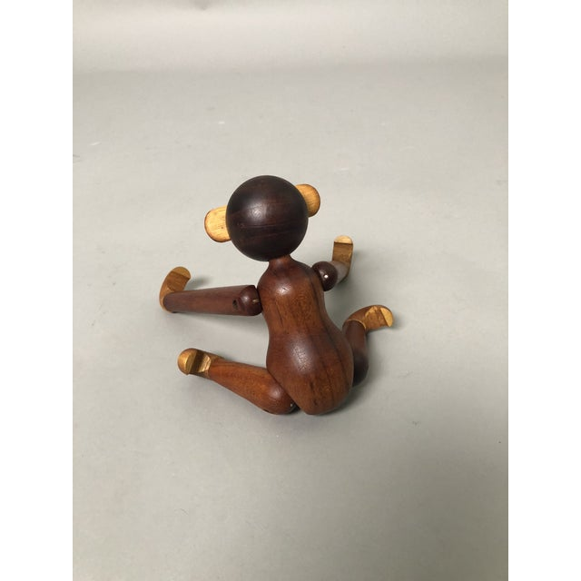 Vintage Kay Bojesen Monkey with rotating arms and legs. Made of teak and limba wood. Danish design. Measurement when arms...