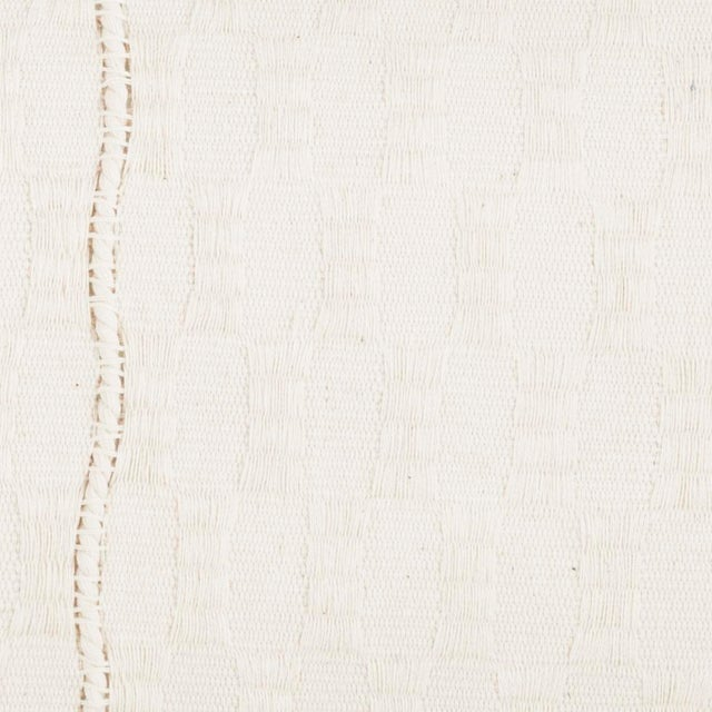 Our easiest, best selling style, now in a super easy natural creamy white. This handwoven textile was made in partnership...