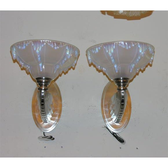 Satin nickel-plated bronze sconces with opalescent glass shades. Shades signed Ezan, France. Two pairs available.