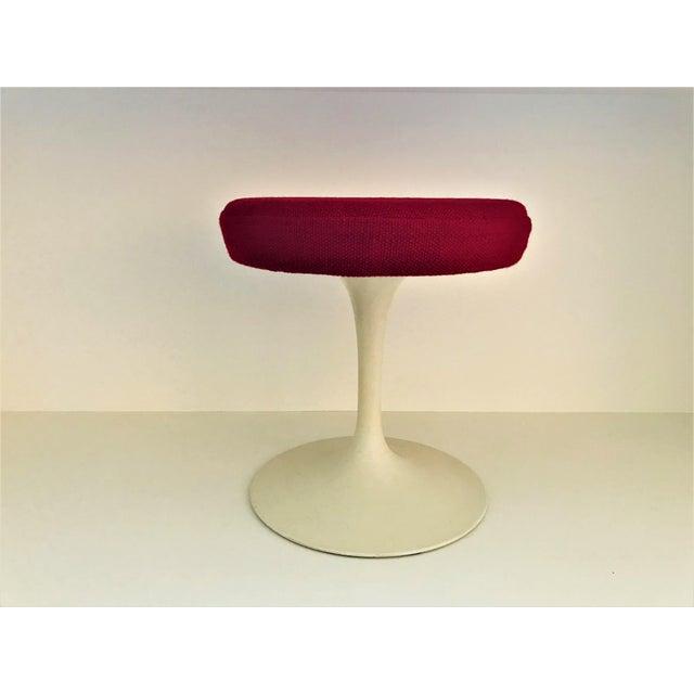 Original, Vintage Saarinen Tulip Stool designed by Eero Saarinen for Knoll, 1957. Cast Aluminum with upholstered wooden...