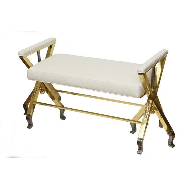 This most unusual and interesting Mid-Century Modern comfortable 3-legged bench is a combination of polished brass and...
