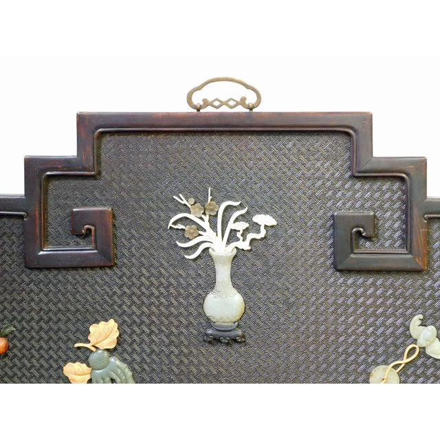 This is a Chinese decorative rosewood wall decor plaque made of tan rosewood which has a nice natural wood pattern. The...