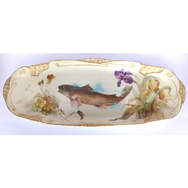 A turn of the century Limoges hand-painted fish platter with elegant scrolled gold work borders signed J. Etienne, 29. Rue...