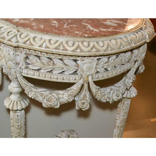 Delightful 19th century pair of French Louis XVI carved and painted consoles. Having wonderfully carved frames with...