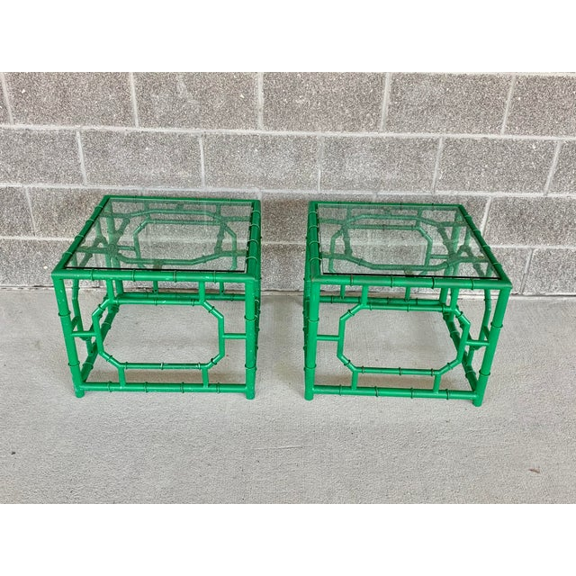 Colorful and fun vintage side tables. Made of metal with a thick glass top. Faux bamboo design and painted a cheerful...
