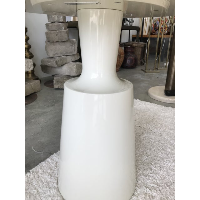 White lacquered wood end table signed Holly Hunt underneath the top. This end table would make a perfect addition to your...