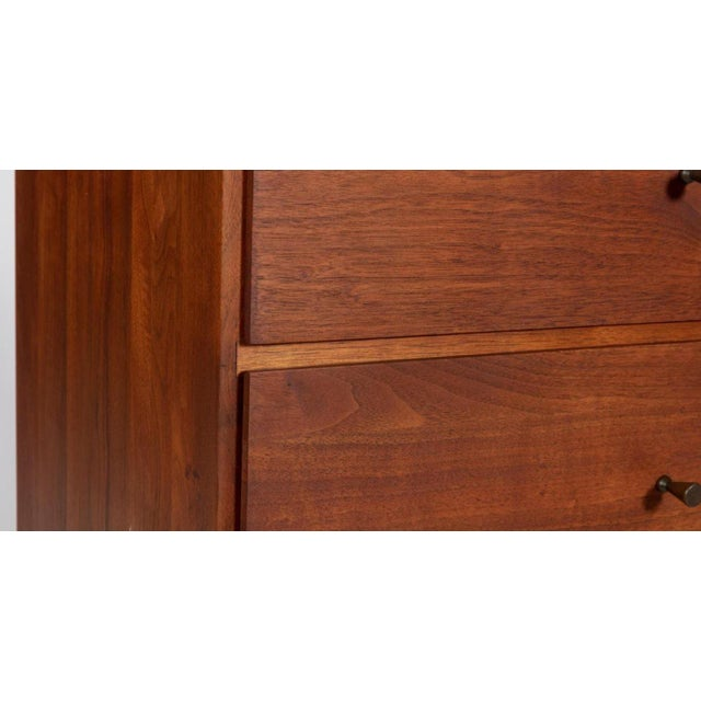 Solid walnut cutie, three drawer chest by Glenn of California. Brass pulls reminiscent of McCobb, but with tapered and...