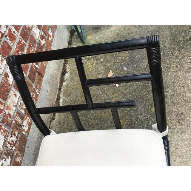 Beautiful vintage bamboo bench. In a dark finish that looks black. Upholstered with a white seat that can be removed....