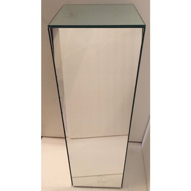 This is a tall mirrored pedestal in excellent vintage condition. It is heavy and sturdy, but has a few light scratches.