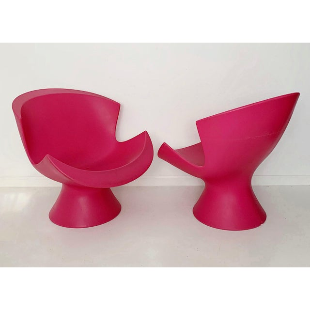 A pair of modern Karim Rashid pink kite lounge chairs in excellent condition. Reasonable offer will be considered. Local...