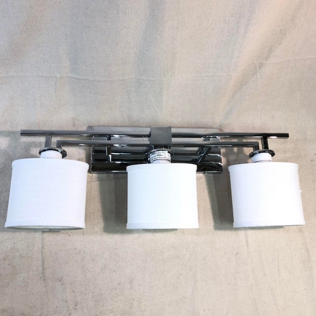 Justice Design 3-Light Polished Chrome Vanity Light - Showroom Sample This elegant three-light sconce features hardware in...
