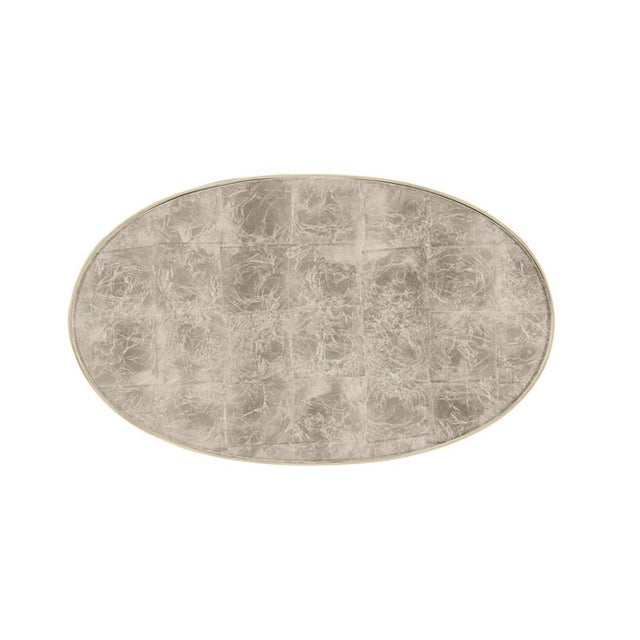 Stylish modern Caracole In the Middle Cocktail Table, metal frame finished in a taupe silver leaf, tempered glass eglomise...