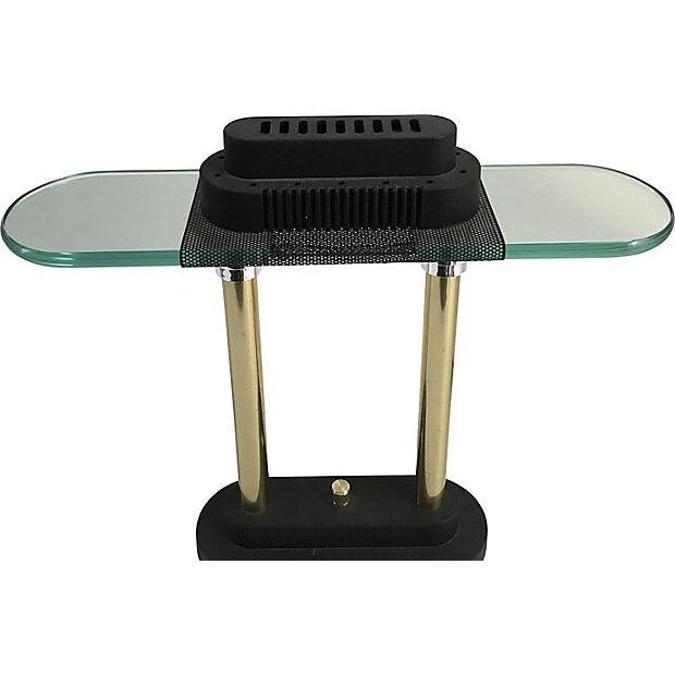 Modern Robert Sonneman for George Kovacs table or desk lamp with two brass cloumsn resting on a matte black base with...