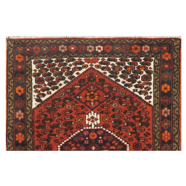 This beautiful rug is hand made, made in iran, Hamedan region. It features a pattern in a vibrant combination of red,...