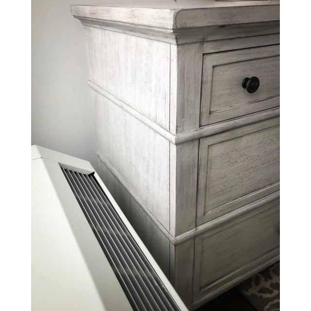 This nightstand features custom ring pulls and turned legs giving it a casual elegance, while its three drawers offer...