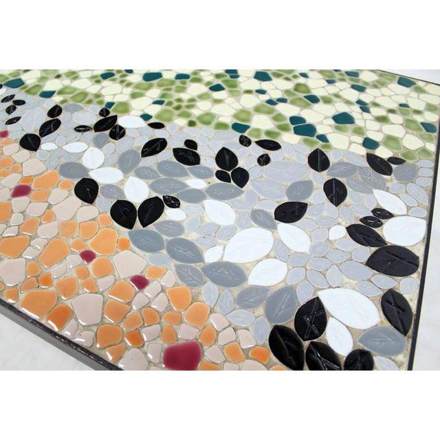 Very sharp looking mid century ebonized wood frame modern mosaic top coffee table. Green red orange grey black.