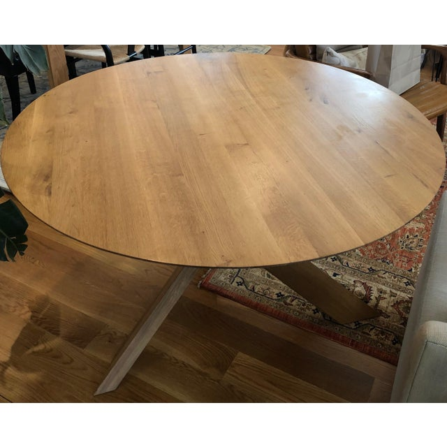 """Lekker Home Oak Circle Dining Table 53.5"""" Diameter x 29.9"""" Height Retail Price $2,189 Finding inspiration for his design..."""