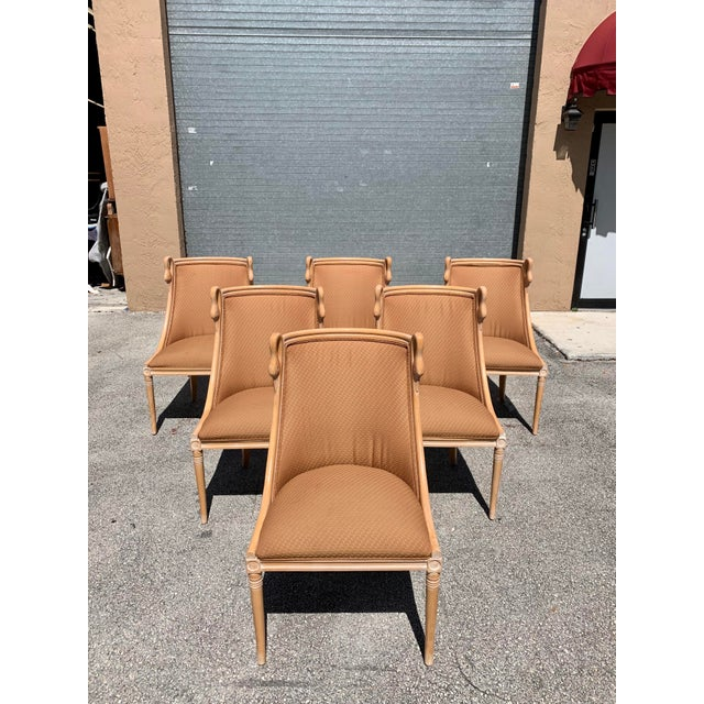 "Set of 6 French Mid-century modern ""Gondola"" Swan neck Dining Chairs Circa 1950s , made of mahogany, the mahogany wood has..."