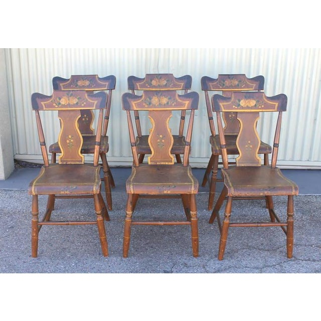 This is a fantastic set of six matching 19th century Lancaster County, Pennsylvania paint decorated chairs. The paint is...