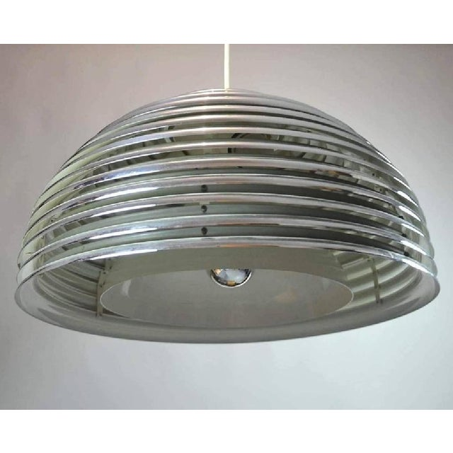This chromed steel pendant model Saturno was designed in 1972 by Kazuo Montozawa for Staff lights. It is fitted with four...