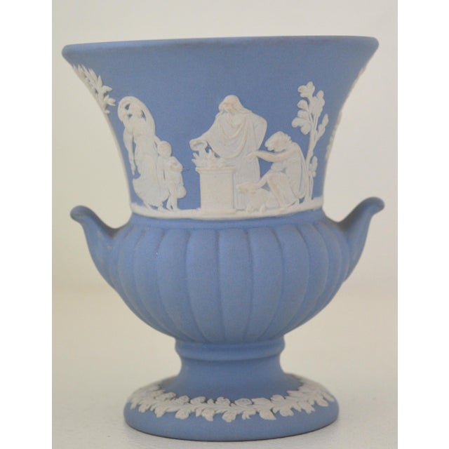 The discontinued and highly collectible jasperware white on blue Campana vase urn. This miniature campana vase is rendered...
