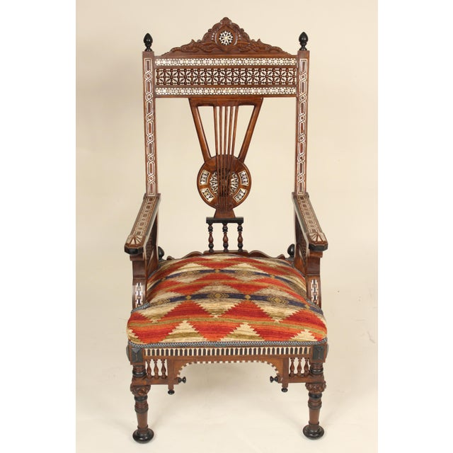 Pair of Middle Eastern mother of pearl inlaid, wood turned and carved armchairs, late 20th century.