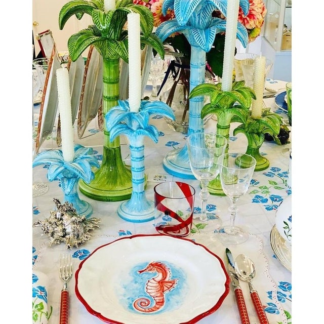 Make your table top more tropical with this palm tree candle holder from Italy. In cool blue, this candle holder is in a...