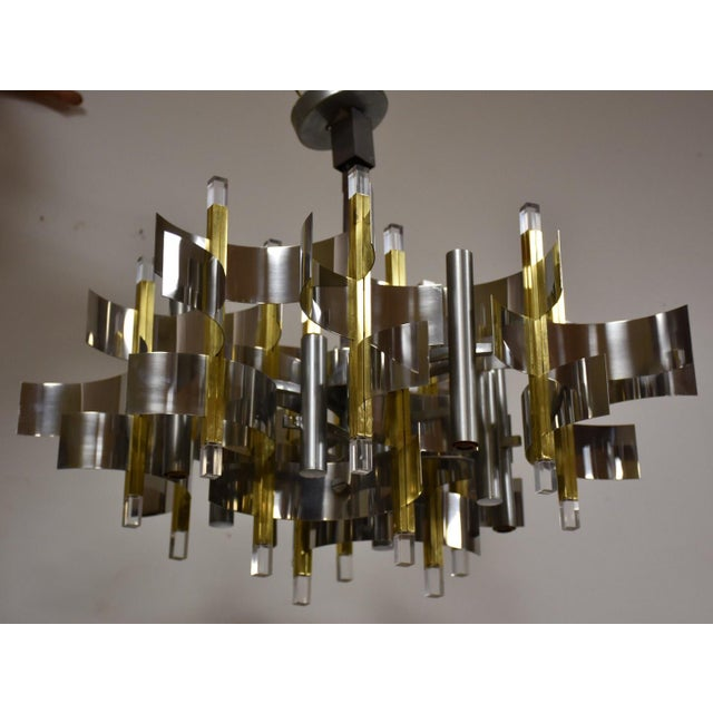 "A gorgeous chrome, brass and lucite chandelier designed by Gaetano Sciolari made in Italy. Diagonal diameter is 28""."