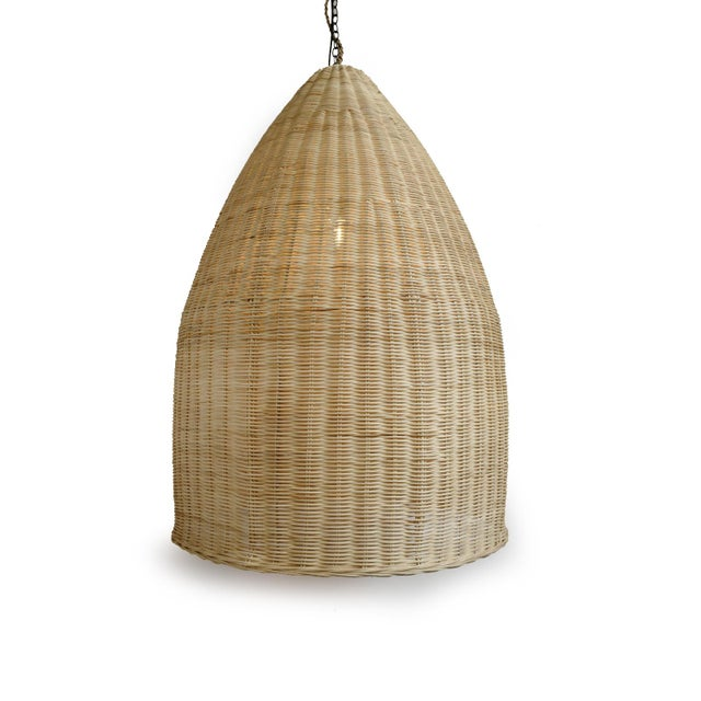Raw woven rattan pod lantern. Beautiful organic material with striking simple modern shape. Includes 3 ft chain and...