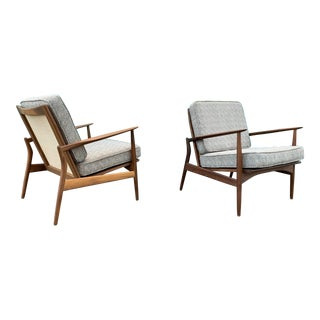 A Pair of Mid Century Style Walnut Sculptural Walnut Caned Lounge Chairs For Sale