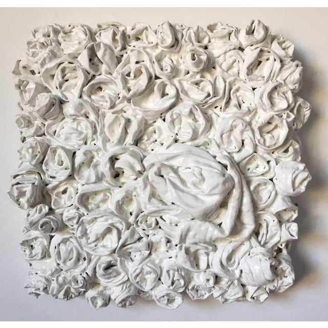 Fabric, glue, vinyl paint and clear glossy sealant on wood. This is part of a series of 9 white rosettes that I created...