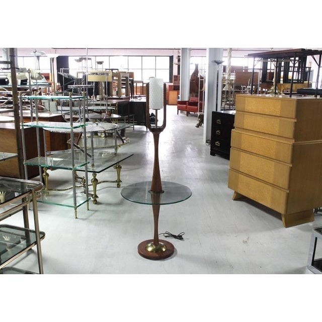 Very nice craftsmanship presented in this sculptural walnut floor lamp. Frosted glass cylinder shape shade. Turned walnut...