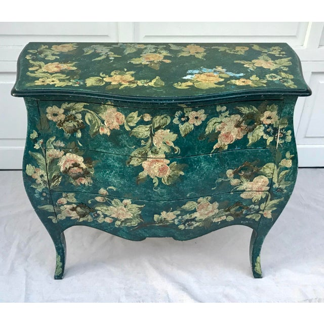 This is a gorgeous bombe chest from France that was hand-painted in the most alluring teal color and adorned with flowers!...