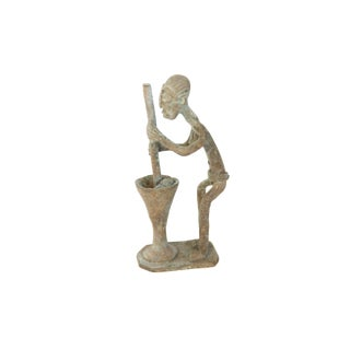 Vintage African Oxidized Copper Woman Churning Butter For Sale
