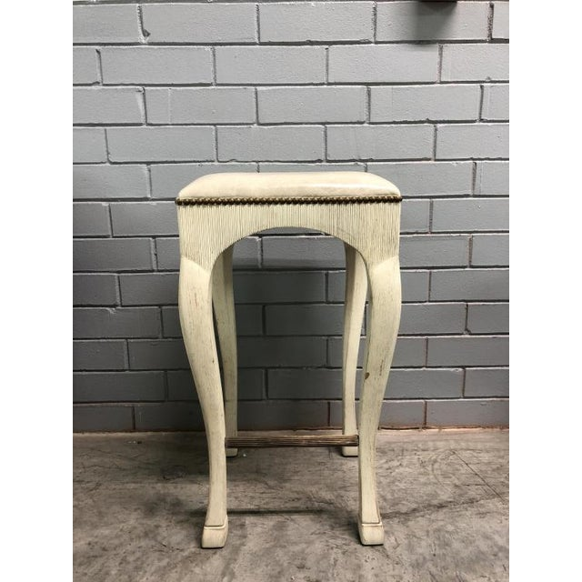 The Galia Bar Stool is a first quality sample that features a Sand leather (C140LR21) with an Alabaster White finish and...