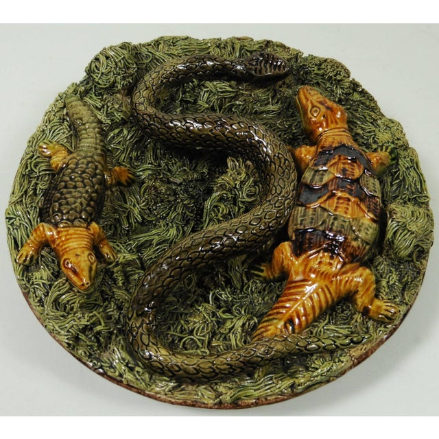 Small Portuguese Palissy wall platter with crocodile, lizard and snake on a green moss signed Manuel Mafra Caldas da...
