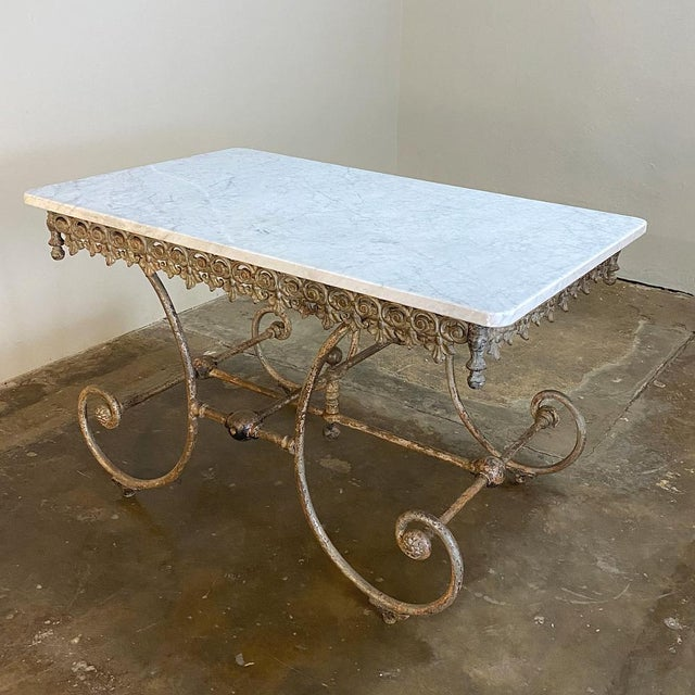 19th Century Iron Marble Top Confectioner's Table is the perfect choice for indoors or outdoors! Fashioned with great...