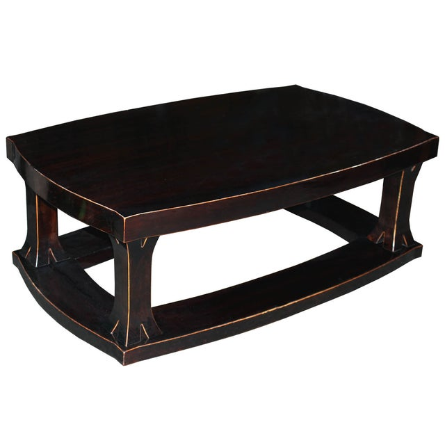 Unique coffee table made with solid elm wood and exposed wood edges to go in front of a sofa in a modern interior.