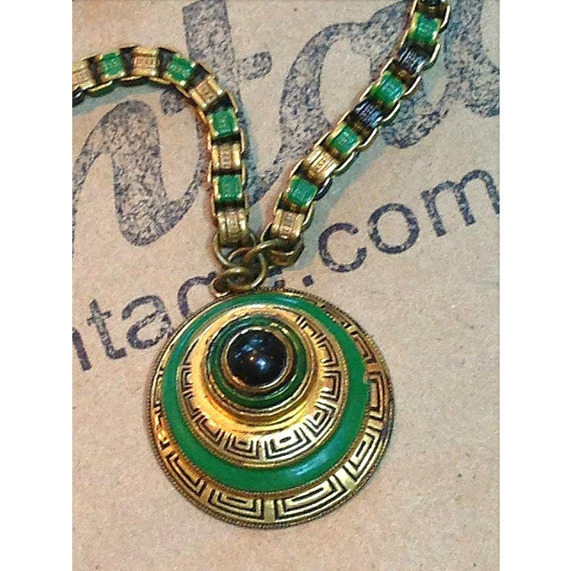Lovely green enamel and gold Art Deco necklace...the pendant is a circular design with alternating levels of gold and...
