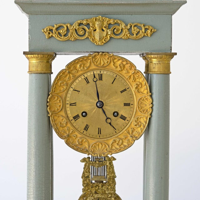 A beautiful 19th century Empire portico mantle clock with 8 day movement and featuring four pillars with fine engine...